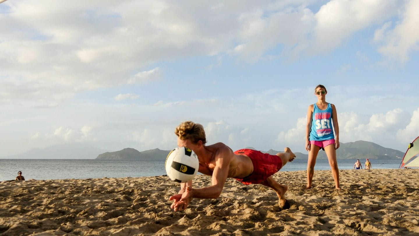 Tcharly playing volleyball on Nevis