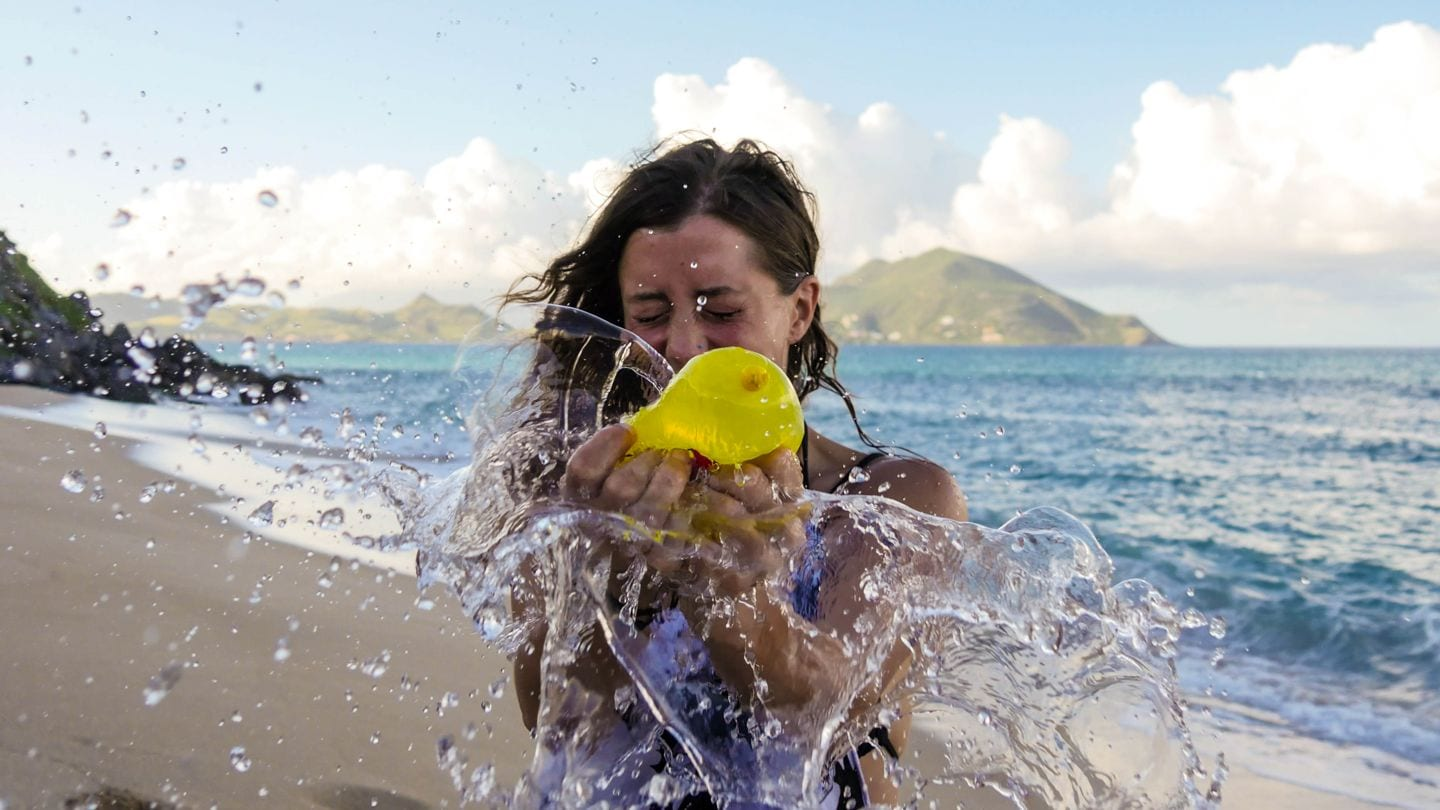 Guide To Nevis - Bursting water balloons on Nevis